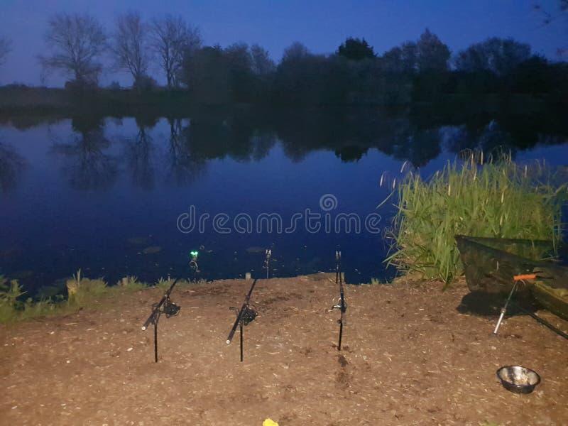 Рыбная ловля nighttime стоковая фотография
