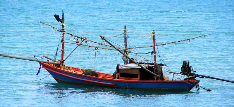 Рыбная ловля и шлюпка стоковое фото