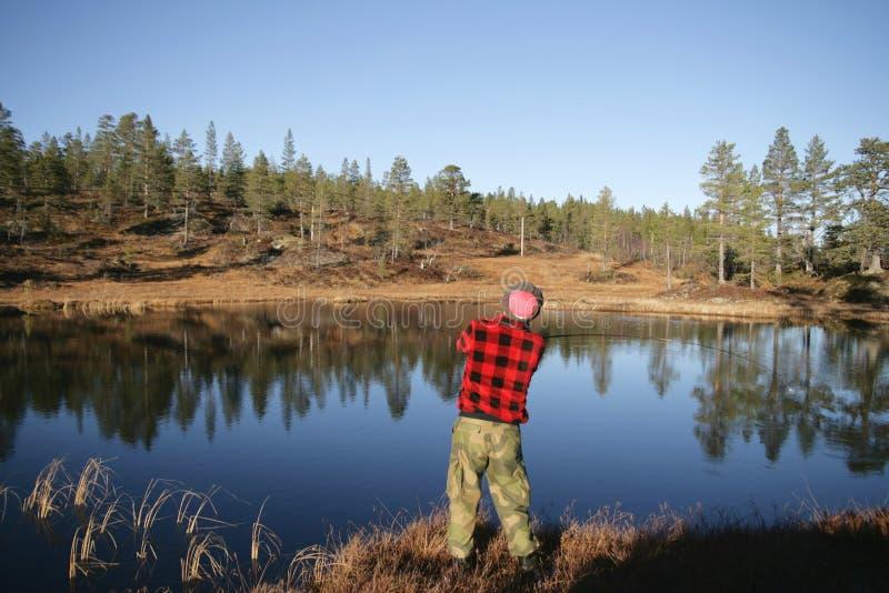 Рыбная ловля человека стоковая фотография rf