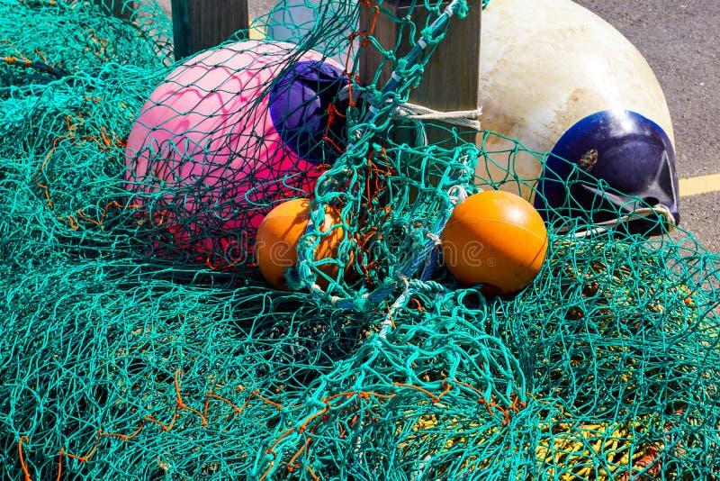 Рыболовные сети и поплавки на западном заливе стоковое фото