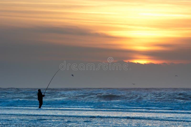рыболовство пляжа стоковые изображения rf