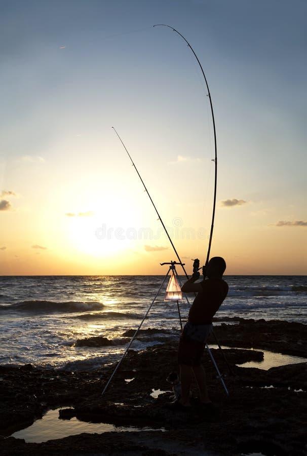 рыболов рассвета стоковые фотографии rf