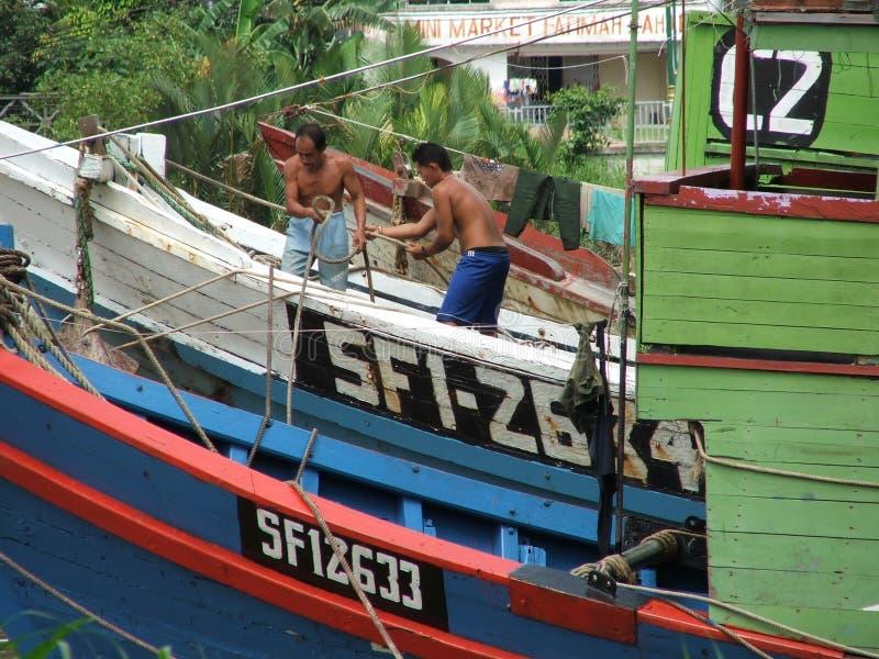 рыболов шлюпки стоковое фото