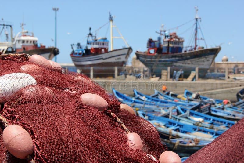 Рыболовные сети и шлюпки стоковая фотография