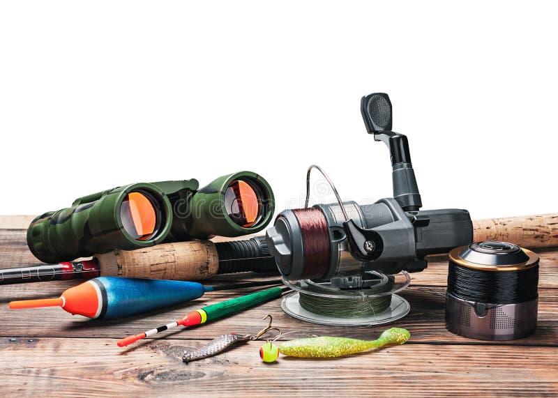 Рыболовные снасти на изолированной таблице стоковая фотография rf