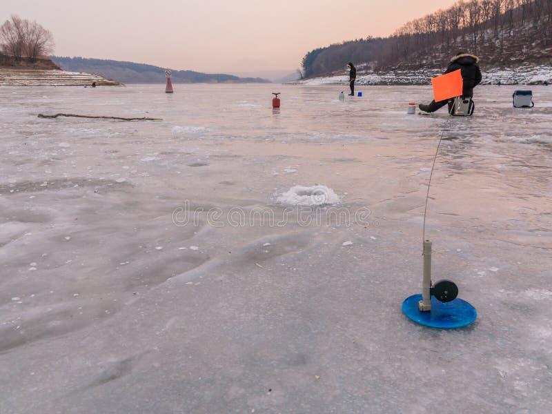 Рыболовство зимы на льде стоковое фото rf