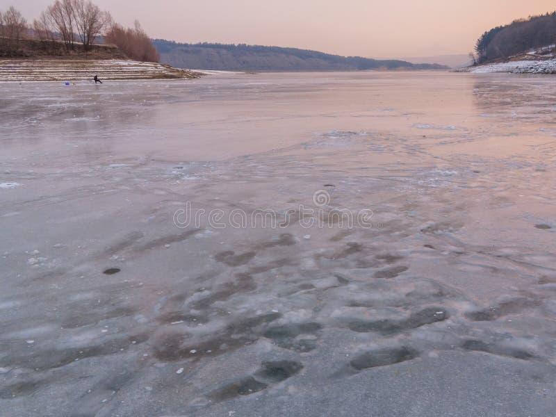 Рыболовство зимы на льде стоковое фото