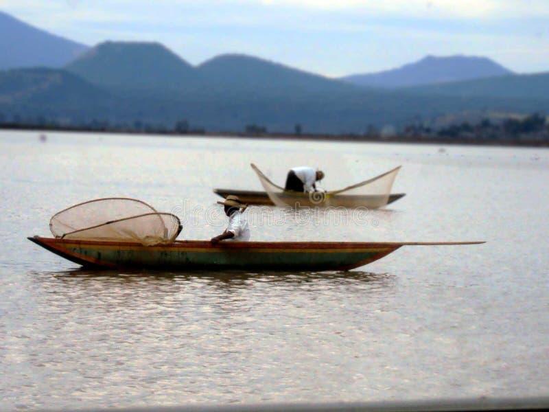 Рыболовы в их ежедневной рыбной ловле стоковое фото