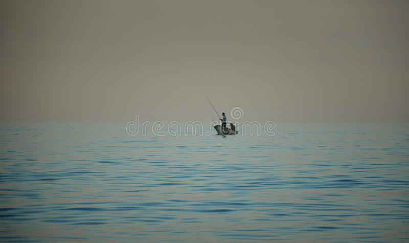 Рыболовы на море стоковое фото