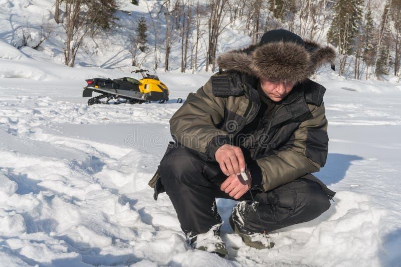 Рыболов зимы стоковые фото