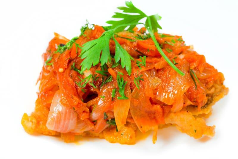рыбы marinade зажаренный в духовке томат стоковые изображения