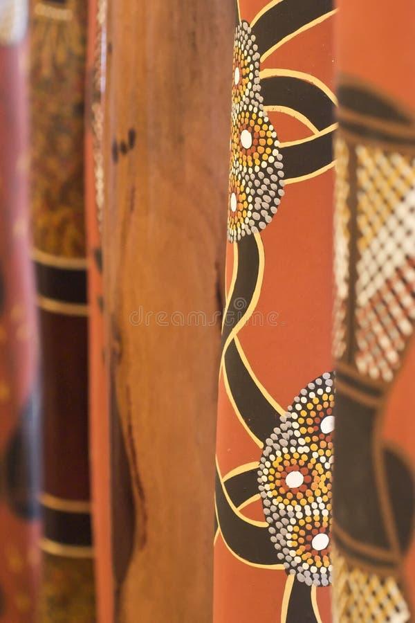 рядок покрашенный didgeridoo s стоковые фотографии rf