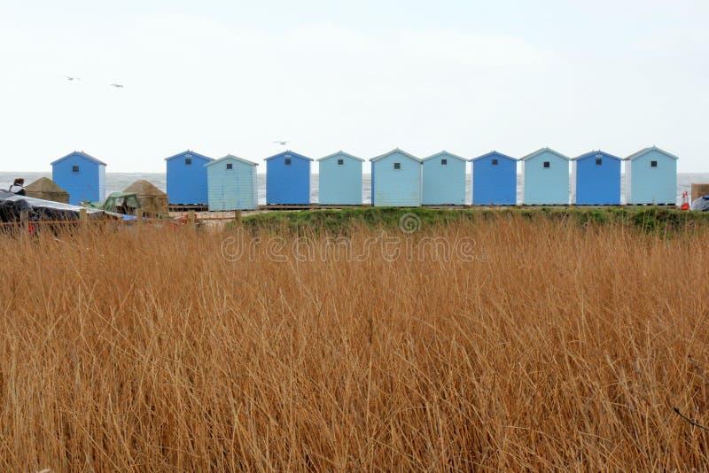 рядок хат пляжа стоковая фотография