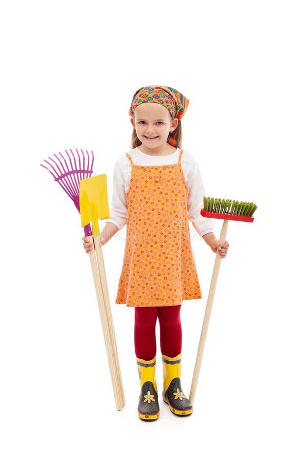 садовничая инструменты весны девушки счастливые стоковые фотографии rf