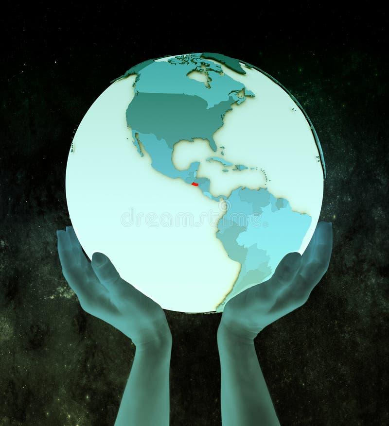 Сальвадор на голубом глобусе в руках стоковая фотография rf