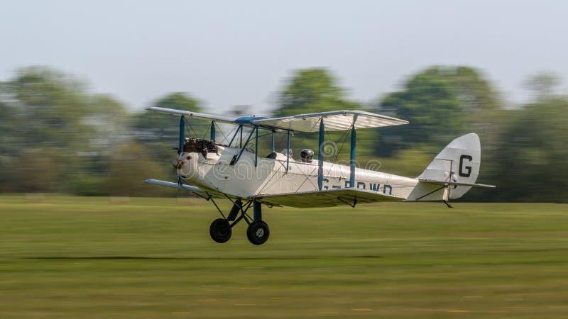 Самолет-биплан 1928 сумеречницы De Havilland DH60X винтажный стоковые фото