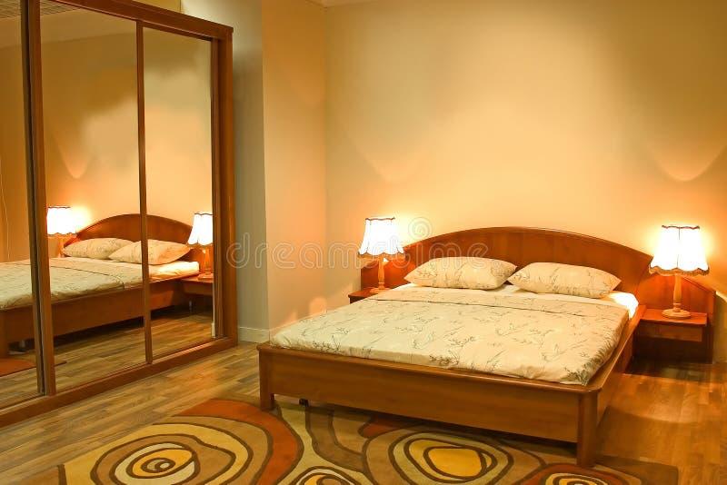 самомоднейшее мебели спальни нутряное стоковые фотографии rf