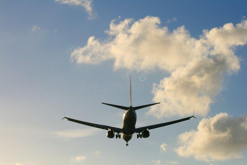 Самолет и облака стоковая фотография rf
