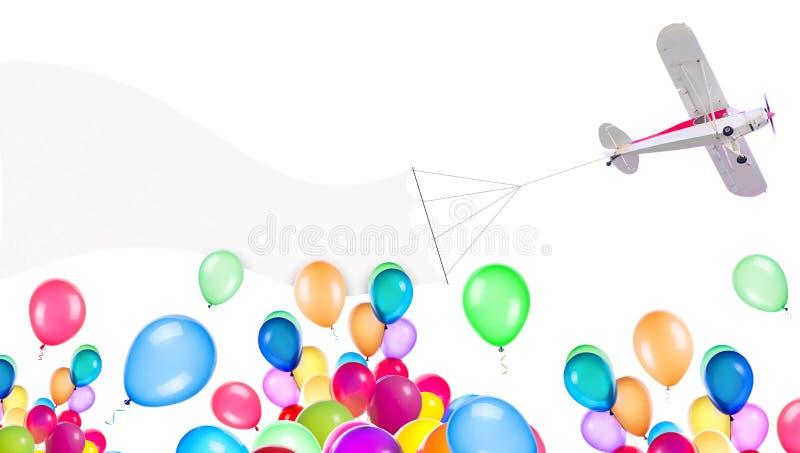 Самолет один двигателя с знаменем и воздушными шарами стоковые изображения rf