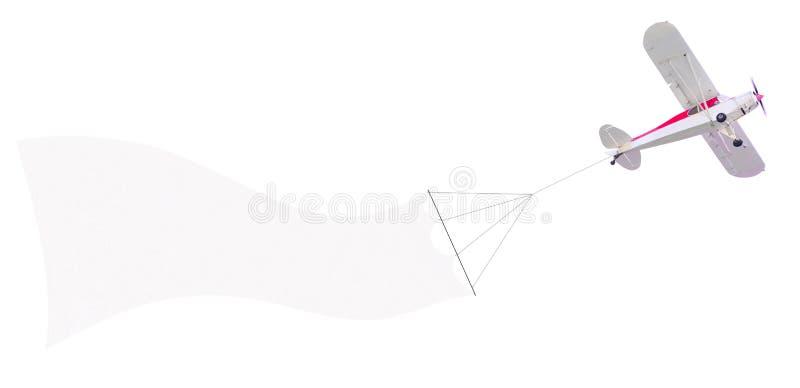 Самолет один двигателя с знаменем стоковая фотография rf