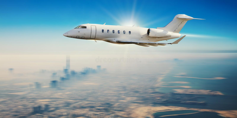 Самолет частного самолета летая над современным городом стоковые фотографии rf