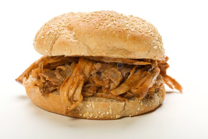 сандвич вытягиванный свининой стоковое изображение