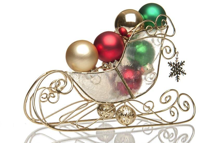 сани рождества шариков латунные стоковые изображения rf