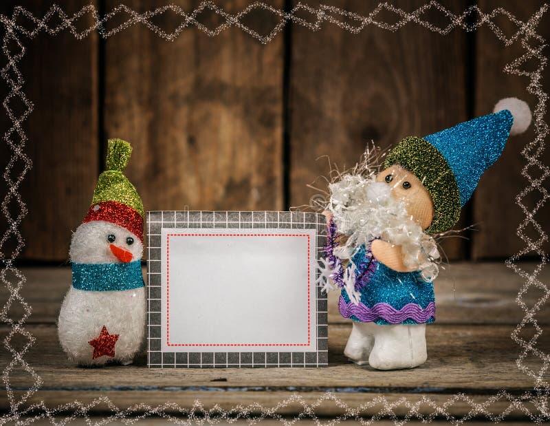 Санта и снеговик с карточкой стоковое изображение