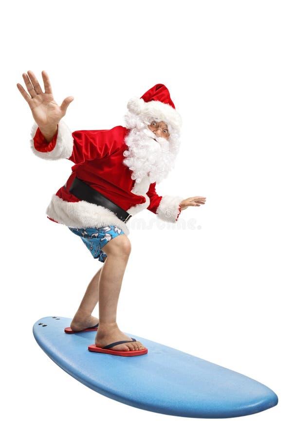 Санта Клаус на празднике занимаясь серфингом стоковое фото rf