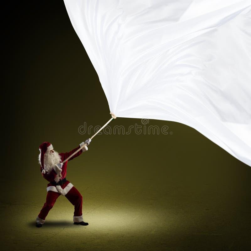 Санта Клаус вытягивает знамя стоковая фотография