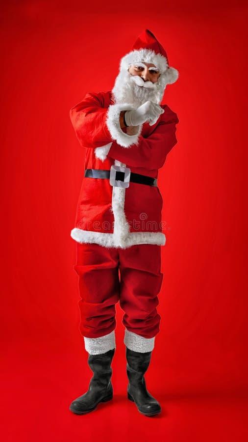Санта Клаус делая зонтиком итальянский жест стоковые изображения rf