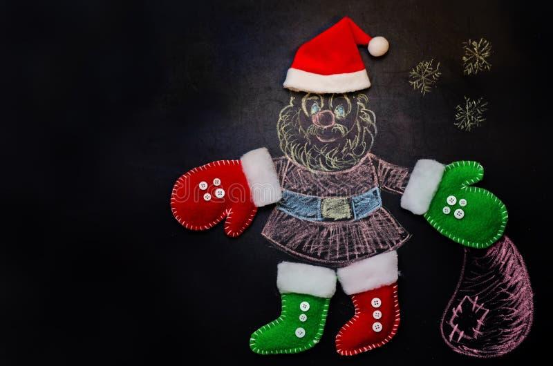 Санта Клаус нарисованный на доске мела стоковые изображения