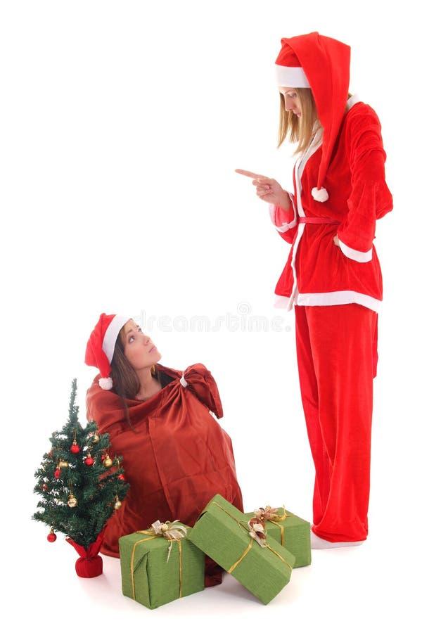 Санта репрессирует gnome которое сидит в мешке стоковая фотография