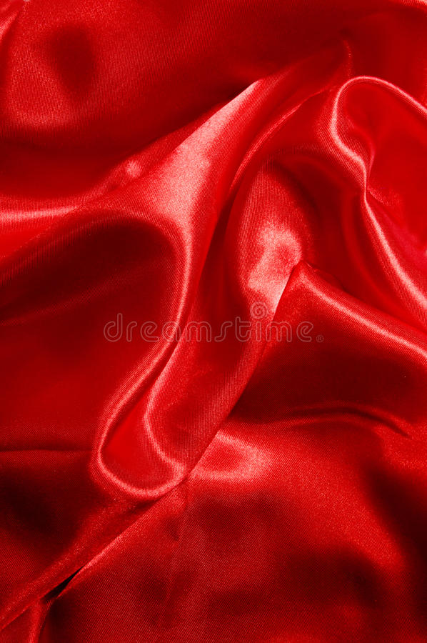 сатинировка красного цвета ткани стоковая фотография