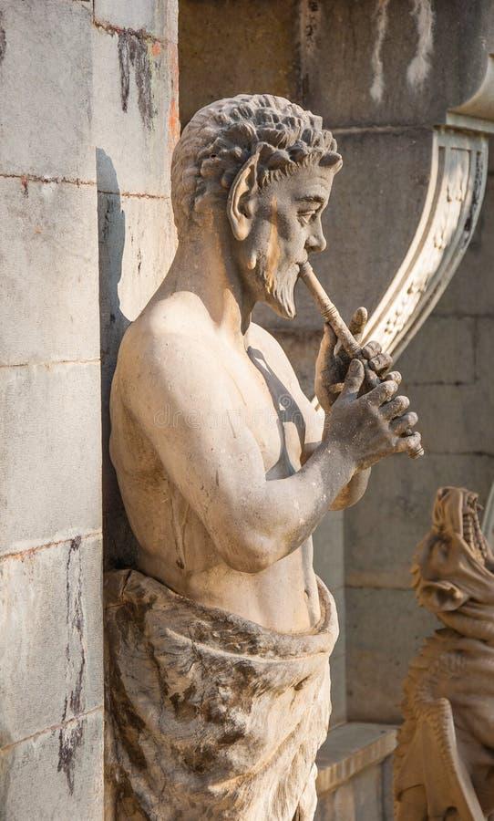 Сатира скульптуры (лоток) стоковые фото