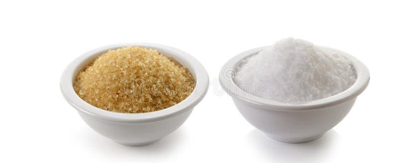 Сахар и соль на белой предпосылке стоковая фотография