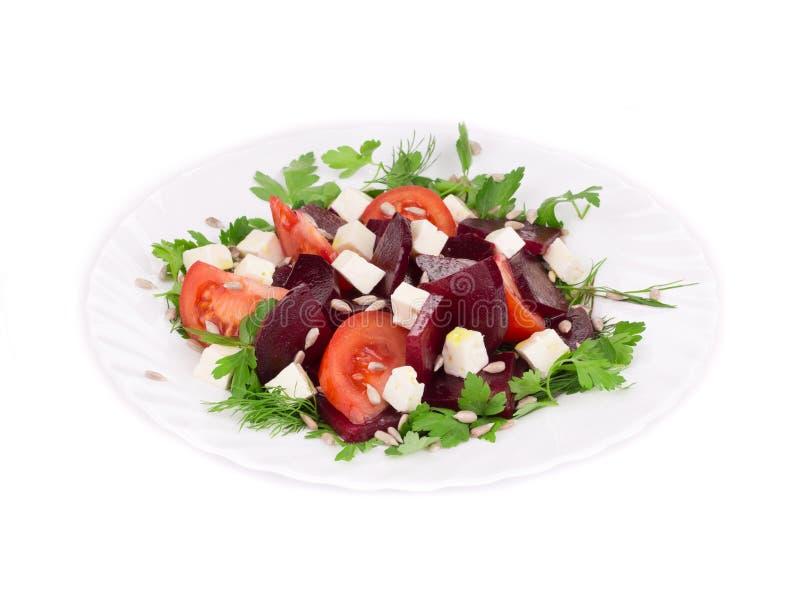 Салат свеклы с томатами и сыром фета стоковая фотография