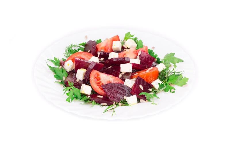 Салат свеклы с томатами и сыром фета стоковое изображение