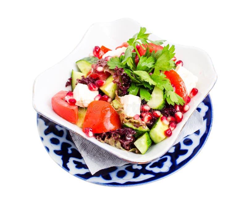 Салат томата с сыром и гранатовым деревом фета стоковое фото rf