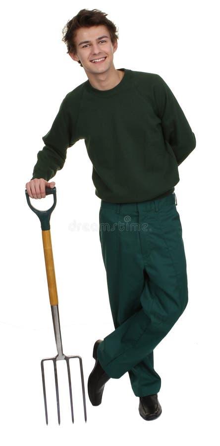 Садовник с вилкой стоковое изображение