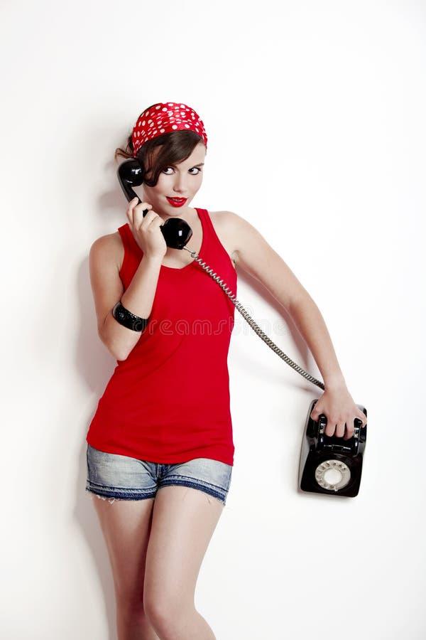 сбор винограда телефона девушки стоковые изображения