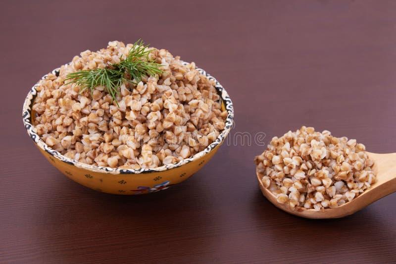 Сваренный гречиха здоровый обед абстрактный коричневый цвет предпосылки выравнивает изображение стоковая фотография
