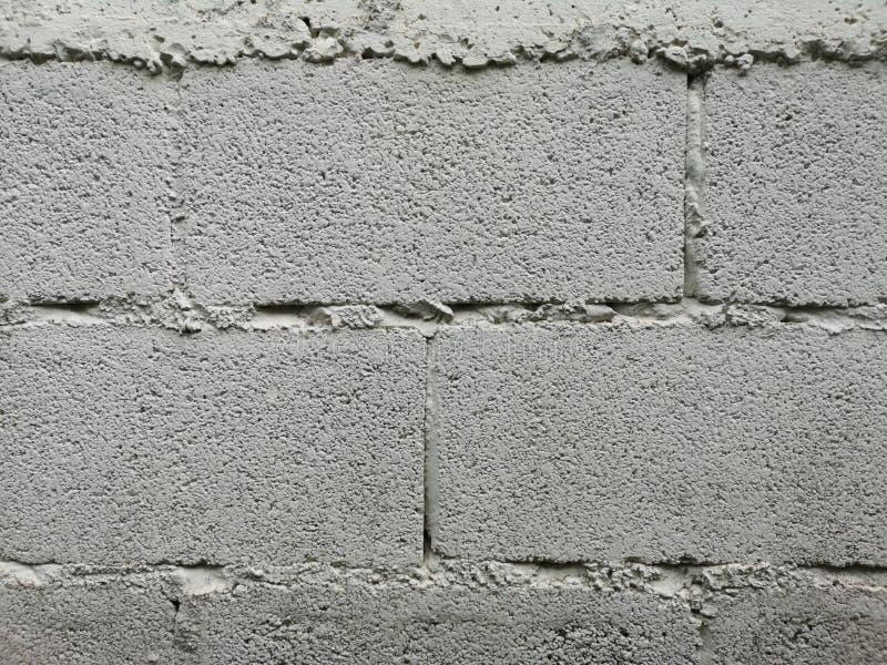Сварка предпосылки материала текстуры белого цвета краски блока кирпичной стены грубая поверхностная соединения с цементным молок стоковые изображения rf