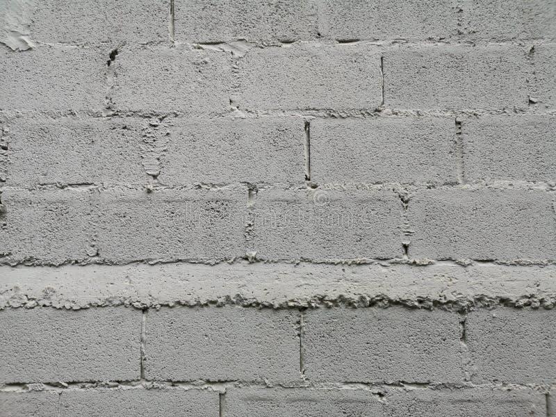 Сварка предпосылки материала текстуры белого цвета краски блока кирпичной стены грубая поверхностная соединения с цементным молок стоковая фотография