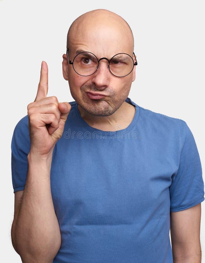 Сварливым forefinger поднятый человеком стоковая фотография rf
