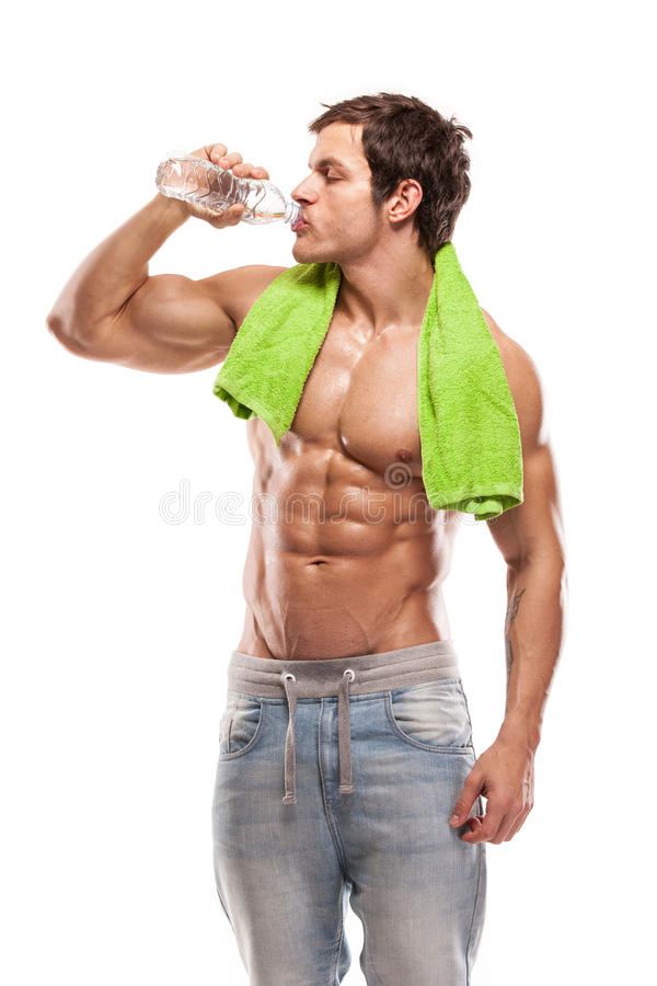 Свежая вода сильного атлетического фитнеса человека модельная выпивая стоковое фото rf
