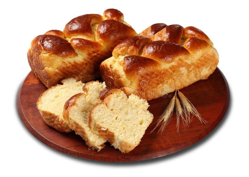 Свежие испеченные вкусные сладостные бриоши, плюшки, хлебцы, хлеб изолированный на белой предпосылке стоковая фотография rf