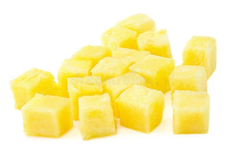 Свежие куски куба ананаса изолированные на белой предпосылке Части ананаса закрывают вверх стоковые изображения