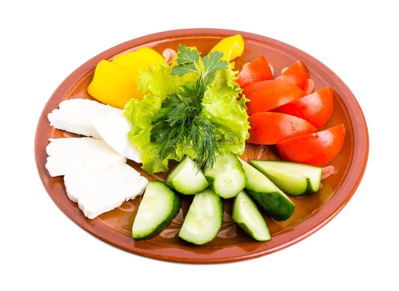 Свежие смешанные овощи и блюдо сыров фета стоковая фотография rf