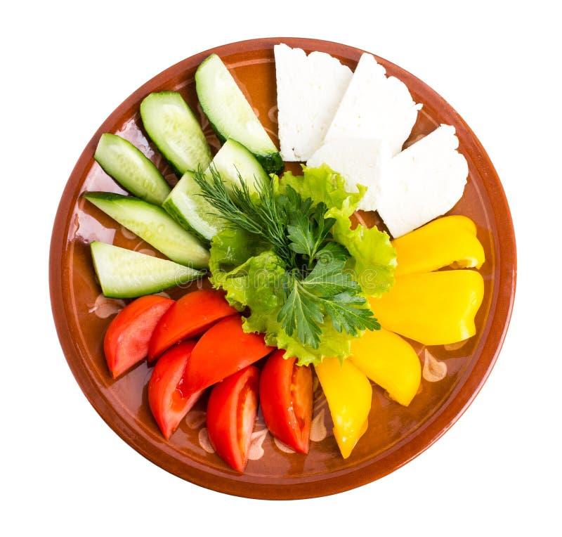 Свежие смешанные овощи и блюдо сыров фета стоковые изображения